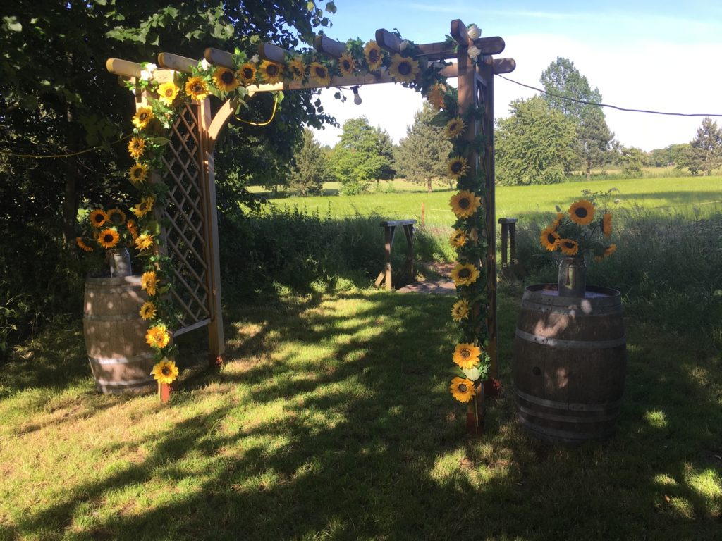 Wedding arch with sunflowers